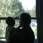 Grandpa and T look out the window